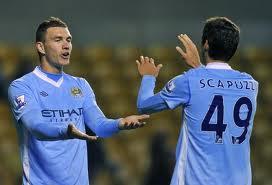 Luca Scapuzzi in maglia City con Dzeko